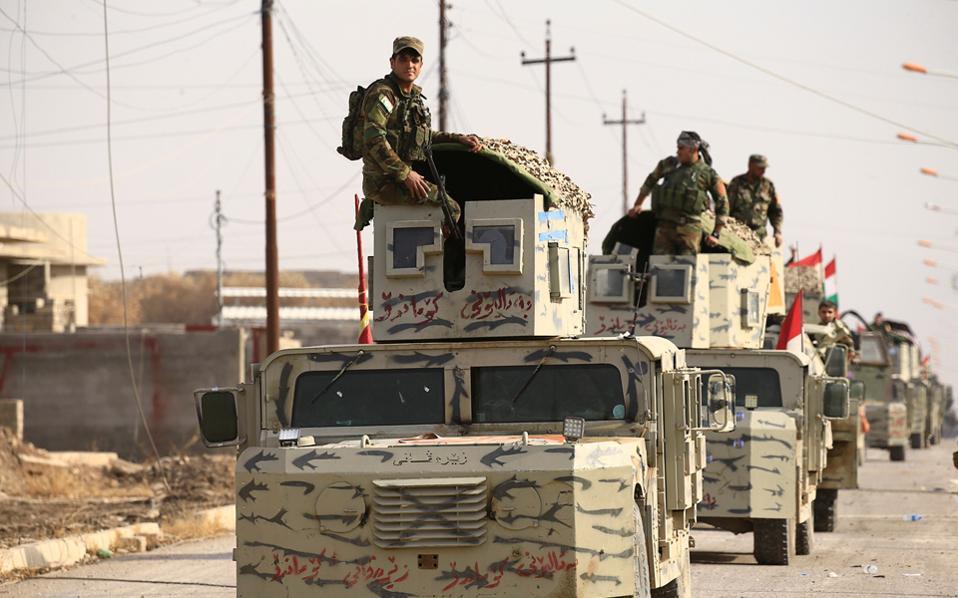 Δυνάμεις Kούρδων Πεσμεργκά εισέρχονται στην κωμόπολη Μπασίκα.
