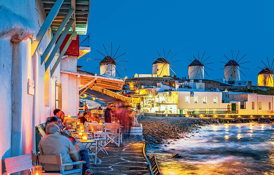 Caprice in Little Venice offers small tables on the sea, with magnificent views of the sunset and the windmills of Mykonos.