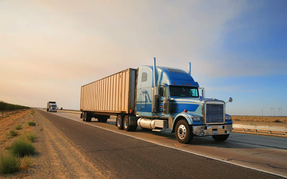 bigstock-truck-on-freeway-12321044
