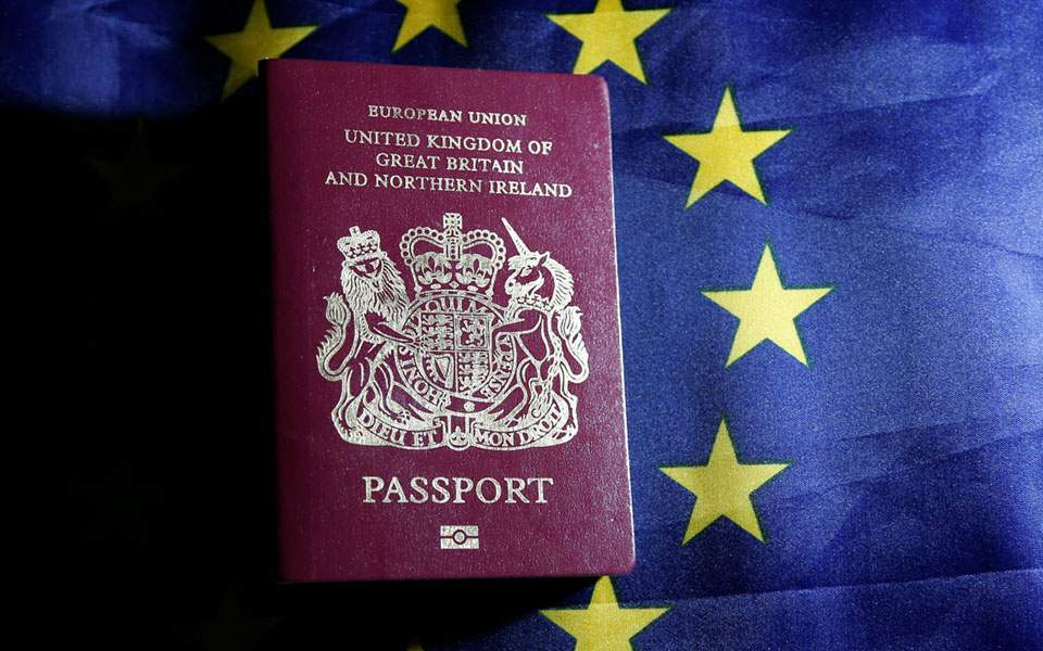 rtx2h63i_passport_in_front_of_flag