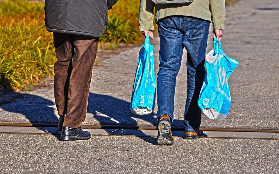 man-walking-plastic-bag