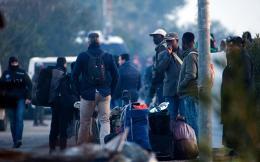 migrants_-th