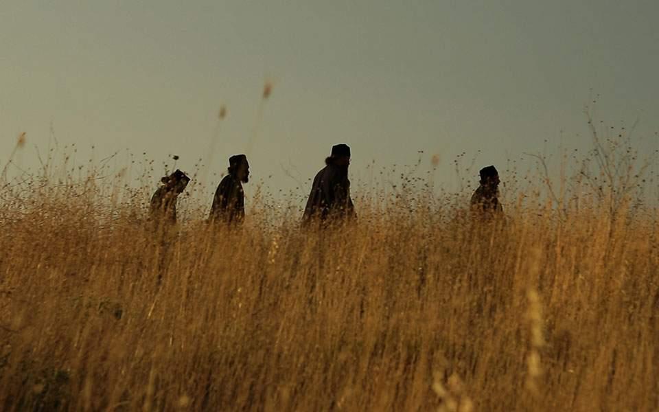 megale-monks-in-fireld