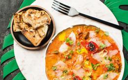 sea-bass-carpaccio-with-sea-urchins-avgotaracho-fish-roe-passion-fruit-olive-oil-and-toasted-bread