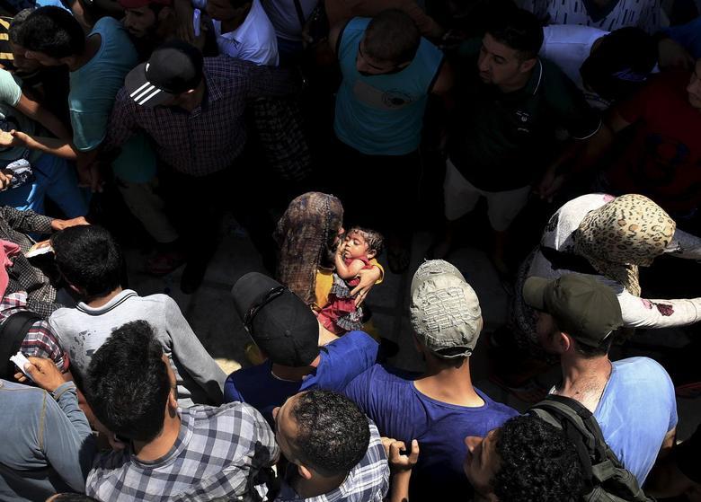 «Μητέρες της προσφυγιάς» μέσα από 15 φωτογραφίες του Reuters 10